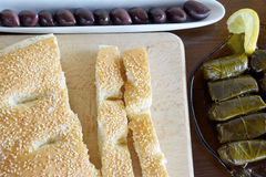 Clean Monday fasting food. Olives, lagana, stuffed grape leaves are some fasting food for Clean Monday stock image