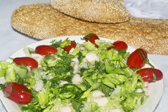 Clean Monday food - bean salad with the greek bread lagana Stock Images