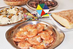Clean Monday food with shrimps, the greek bread lagana and decorative kites Stock Images