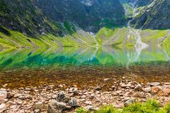 Clean mountain cold lake Czarny Staw close-up. On a sunny day royalty free stock image