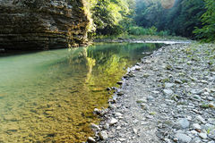 Clean mountain river. River in the mountains, clear water, rocky bottom Stock Photography
