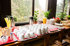 Clean mugs, cups and glasses on the table. Clean drinking recipients on the table- ready tor serve coffe, tea, juice or water Royalty Free Stock Photos