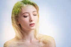 Tender beautiful woman unifying with nature. Clean nature. Vulnerable positive calm woman closing her eyes while grasping inspiration and enjoying her thoughts royalty free stock photos