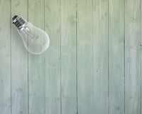 Clean new bulb on wooden surface Stock Photos