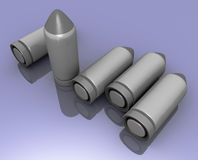 Clean new glossy bullets ready / 3d image blue. Five bullets on the picture. Blue background Royalty Free Stock Photography