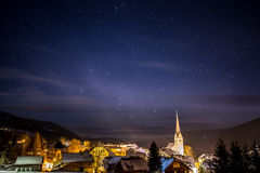 Clean night starry sky over highland Austrian town Royalty Free Stock Images