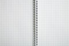 Clean notebook. Photo of an empty spiral checked notebook Stock Image