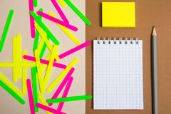 Clean notebook and colorful counting sticks. Pencil and sticky note paper Royalty Free Stock Image