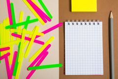 Clean notebook and colorful counting sticks. Pencil and sticky note paper Stock Images