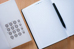 Clean Notebook, Pen And Telephone On Desk Royalty Free Stock Photography