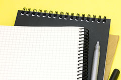 Clean notepads, envelope, pen and marker on yellow writing desk Stock Photography