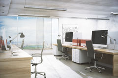 Clean office interior. Clean office room interior with workplace, equipment, city view and daylight. Real estate, workspace, business concept. 3D Rendering Stock Images