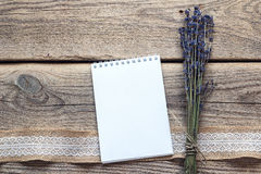 Clean open notebook with lavender flowers bouquet on rustic wood royalty free stock images