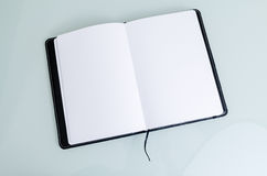 Clean Open Notebook Paper in Black Cover Royalty Free Stock Image