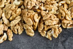 Clean organic raw kernel walnuts. On a table royalty free stock photography