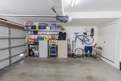 Clean Organized Suburban Garage. Organized clean suburban residential two car garage with tools, file cabinets and sports equipment royalty free stock photo