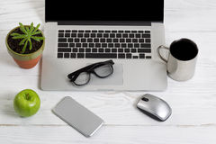 Clean and organized work space on white desktop Royalty Free Stock Image