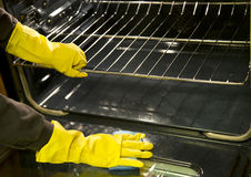 Clean the oven with sponge background Stock Photo