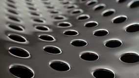 Clean Perforated Metal with Blinking Reflections stock footage