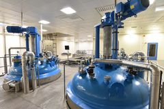 Clean pipelines and tanks in an industrial plant stock image