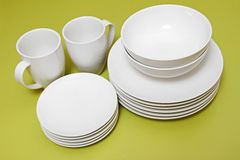 Clean plates bowls and cups Royalty Free Stock Photo