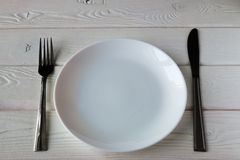 Clean plates and cutlery Stock Photography