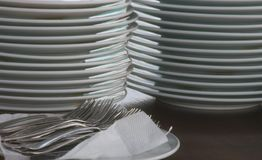 Clean plates and forks. On the table Royalty Free Stock Photography