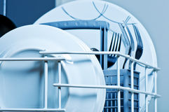 Clean plates and forks inside  dishwasher. Plates and forks inside  dishwasher Stock Images