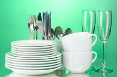 Clean plates, glasses, cups and cutlery Stock Photo