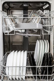 Clean plates and glasses in dishwasher machine Royalty Free Stock Photos