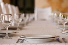 Clean plates and glasses on festive table Royalty Free Stock Photography