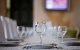 Clean plates and glasses on festive table Stock Images