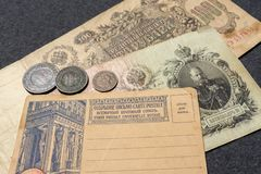 Clean Postcard. Old Russian banknotes and some coins. Russia, early 20th century.  royalty free stock photo
