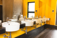 Clean public toilet yellow colour room Stock Photography