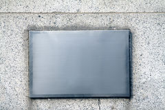Clean and pure metals background. Square metal background on the wall Stock Image