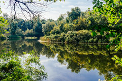 Clean quiet river. Reflection of heaven in the water Royalty Free Stock Photo