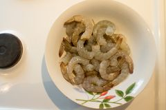 Clean raw fresh prawns in the bowl on the kitchen. Ready to cook royalty free stock image