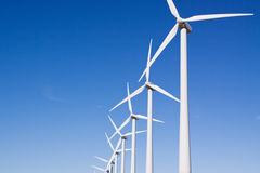 Clean renewable energy. Wind turbines for clean alternative energy Royalty Free Stock Photo