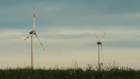 Clean and Renewable Energy, Wind Power, Turbine, Windmill, Energy Production. Wind turbines in the field, overcast. Clean and Renewable Energy, Wind Power Stock Photography