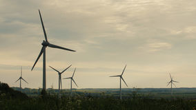 Clean and Renewable Energy, Wind Power, Turbine, Windmill, Energy Production. Wind turbines in the field, overcast. Clean and Renewable Energy, Wind Power Royalty Free Stock Photos