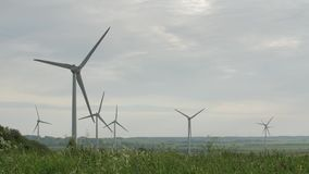 Clean and Renewable Energy, Wind Power, Turbine, Windmill, Energy Production. Wind turbines in the field, overcast. Clean and Renewable Energy, Wind Power stock video