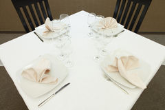 Clean Restaurant table prepared for guests. Restaurant table with plates and glasses Royalty Free Stock Photography