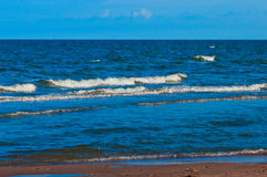 Clean sand beach and blue sky and sea Royalty Free Stock Photo