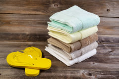 Clean Sandals and Towels on Weathered Wood Stock Photos