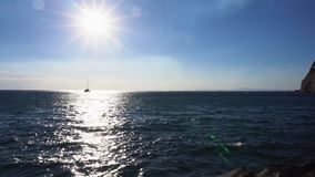 Clean sea water. With sun path and ship stock footage