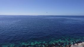 Clean sea water. And clear blue sky stock footage