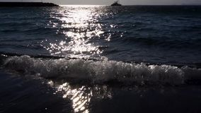 Clean sea water. Sea water and yach with sun glares in back light, Meta di Sorrento, Italy stock video footage