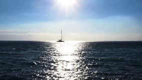 Clean sea water. Sea water, yacht and sunshine in back harsh light, Italy stock video footage