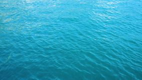 Clean sea water. Surface of clean turquious deep sea water with waves stock video footage
