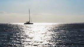 Clean sea water. Sea water, yacht boat and sunshine in back harsh light, Italy stock footage